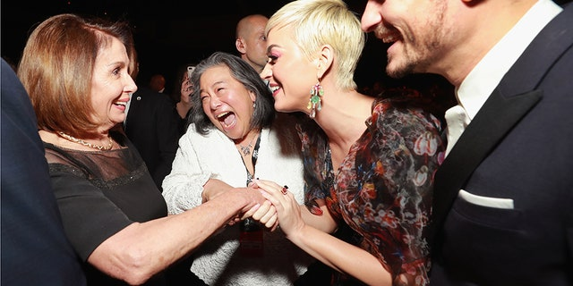 Nancy Pelosi (L), Katy Perry (2nd R) and Orlando Bloom (R) participate in the MusiCares Year of the Year, called Dolly Parton in Los Angeles Convention Center on February 8, 2019 in Los Angeles, California.