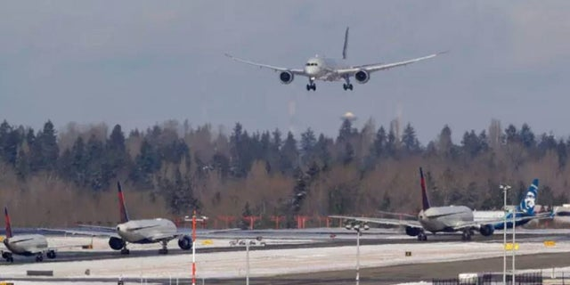 Feb 5: A Virgin Atlantic flight comes in for a landing above other taxiing aircraft, Tuesday, Feb. 5, 2019, at Seattle-Tacoma International Airport in Seattle. (AP Photo/Ted S. Warren)