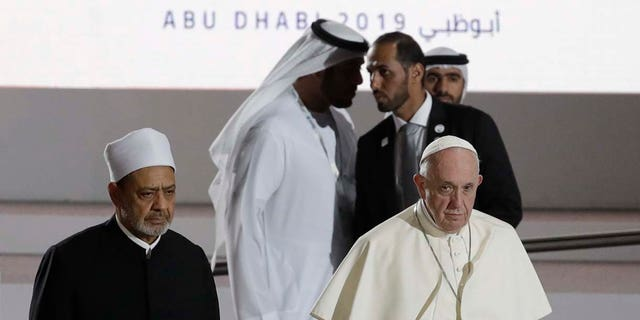 Pope Francis is flanked by Sheikh Ahmed el-Tayeb, the grand imam of Egypt's Al-Azhar as they arrive for an Interreligious meeting at the Founder's Memorial in Abu Dhabi, United Arab Emirates, Monday, Feb. 4, 2019. (AP Photo/Andrew Medichini)