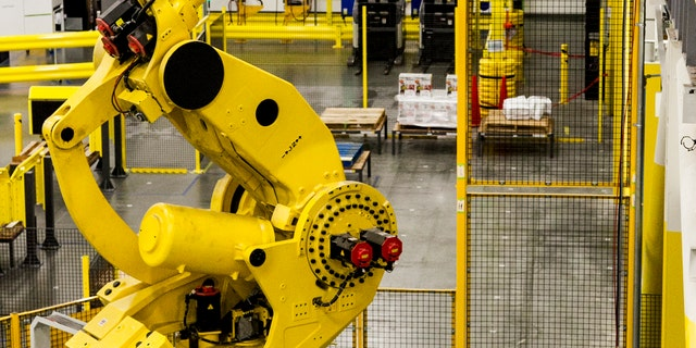 A robot is seen at an Amazon warehouse in the image above.