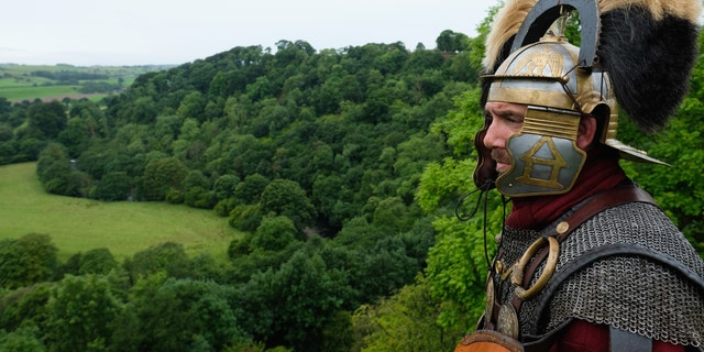 File photo - A reenactor dressed as a Roman soldier stands guard looking out over the countryside of Cumbria from the Birdoswald Roman Fort as the lives of Roman Legionnaires are re-enacted during the Hadrian's Wall Live event on Sept. 3, 2016 in Carlisle, England. (Photo by Ian Forsyth/Getty Images)