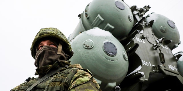 A service man or an S-400 triumph missile system crew on standby as an anti-aircraft military unit of the Russian Air Force and the Russi in Southern Military District enters combat duty near the Crimean town of Dzhankoy.