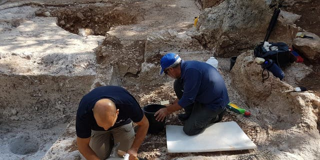 Archaeologists working on the ancient site.