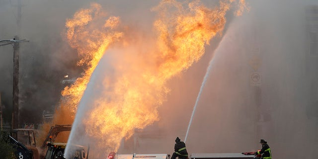 Firefighters battle a fire on Geary Boulevard in San Francisco, California on Wednesday.