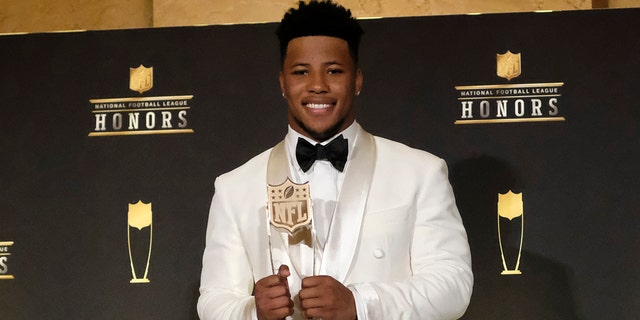 Saquon Barkley, of the New York Giants, poses with the award for AP offensive rookie of the year.  (Photo by AJ Mast/Invision for NFL/AP Images)