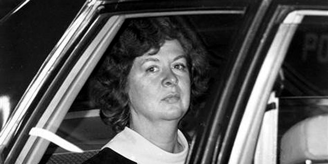 Sara Jane Moore looks out the window of a U.S. marshal's car in San Francisco, Dec. 16, 1975, on her way to the federal court where U.S. District Judge Samuel Conti accepted her plea of guilty to the attempted assassination of President Gerald Ford.