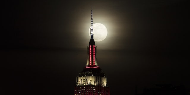 The Empire State building is seen as a super moon rises in New York, United States on February 19, 2019