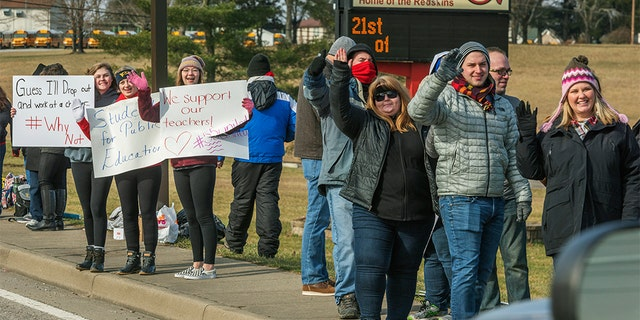 Teachers, students and supporters protested outside of Hurricane High School in Putnam County, West Virginia on Tuesday, Feb. 19, 2019.