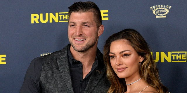 """Tim Tebow and fiancée Demi-Leigh Nel-Peters attend the premiere of """"Run The Race"""" on February 11, 2019 in Hollywood, Calif."""