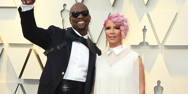 Terry Crews, left, and Rebecca King-Crews arrive at the Oscars on Sunday, Feb. 24, 2019, at the Dolby Theatre in Los Angeles.