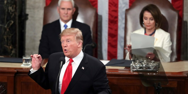 President Trump delivers his State of the Union address on Tuesday night, flanked by Vice President Mike Pence and House Speaker Nancy Pelosi. (AP Photo/Andrew Harnik)