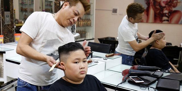 To Gia Huy, 9, has a haircut in a North Korean leader Kim Jong Un style in a haircut salon in Hanoi, Vietnam February 19, 2019.