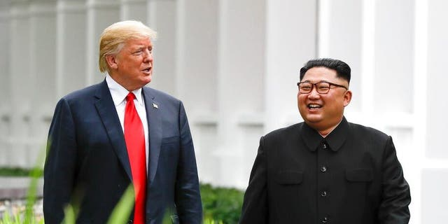 FILE - In this June 12, 2018, file photo, President Donald Trump, left, and North Korea leader Kim Jong Un walk from their lunch at the Capella resort on Sentosa Island in Singapore. (AP Photo/Evan Vucci, File)