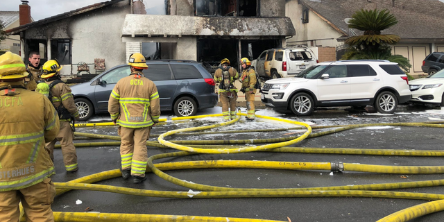 A small plane crashed in a residential California neighborhood on Sunday and set a single family home ablaze, officials said.