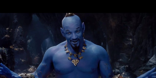 Will Smith says he laughed off the negative backlash to his genie character.