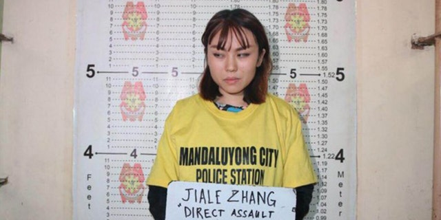 Zhang Jaile, 23, faces deportation from the Philippines after throwing a cup of soybean pudding on a police officer at a train station in Manila.