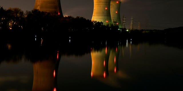FILE - In this file photo of Nov. 2, 2006, cooling towers of the Three Mile Island nuclear power plant are reflected in the Susquehanna River in this time exposure photograph in Middletown, Pa. Forty years after Three Mile Island became synonymous with America's worst commercial nuclear power accident, the prospect of bailing out nuclear power plants is stirring debate at the highest levels of Pennsylvania and the federal government. (AP Photo/Carolyn Kaster, File)
