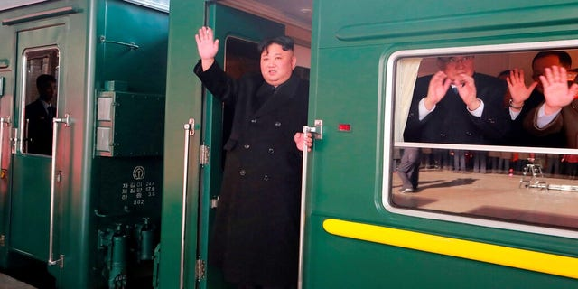 North Korean leader Kim Jong Un, on a recent train ride, a change of pace for a man used to commuting in luxury vehicles.  (Korean Central News Agency/Korea News Service via AP)