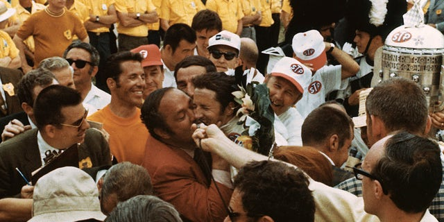 Team owner Andy Granatelli gave Mario Andretti a big kiss after his 1969 Indy 500 victory.