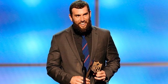Andrew Luck of the Indianapolis Colts accepts the award for AP comeback player of the year. (Photo by Paul Abell/Invision for NFL/AP Images)