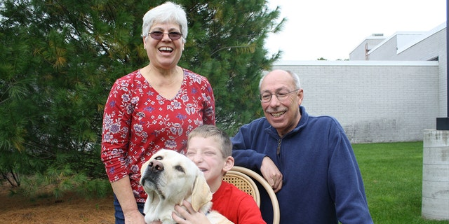 Justin and his grandparents Carl and Michele with Holiday in an old photo