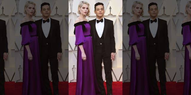 Lucy Boynton, left, and Rami Malek arrive at the Oscars on Sunday, Feb. 24, 2019, at the Dolby Theatre in Los Angeles.
