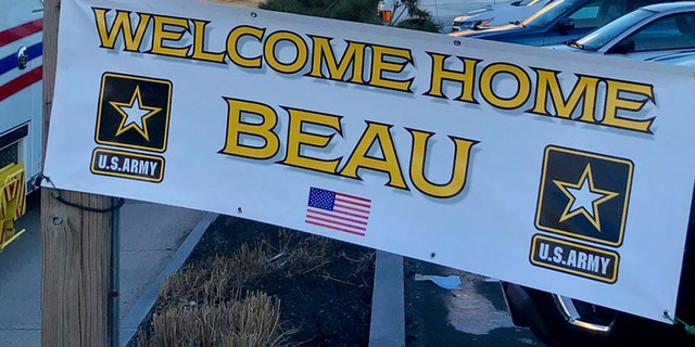 One of the signs greeting Beau Schlichting at his surprise homecoming Saturday in Winthrip, Mass., after a nine-month deployment in Afghanistan with the U.S. Army.