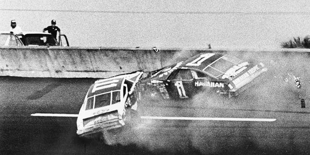 Donnie Allison, in car 1, and Cale Yarborough, in car 11, crashed on the last lap of the Daytona 500 to put Richard Petty in Victory Lane.