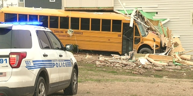 A North Carolina school bus with 15 students and driver crashed into a building on the way to a middle school.
