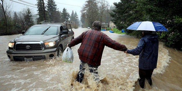 Residents of Armstrong Woods Road return home after the road became impassable for most vehicles on Tuesday, February 26, 2019 in Guerneville, California.