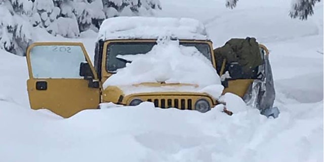 The Jeep got stuck in the snow at the Mendocino National Forest.