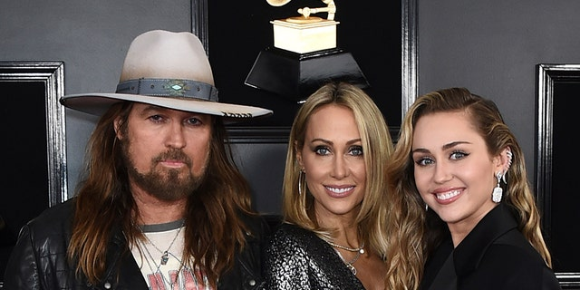 Billy Ray Cyrus, left, Tish Cyrus and Miley Cyrus arrive at the 61st Annual Grammy Awards at the Staples Center on Sunday, February 10, 2019 in Los Angeles.