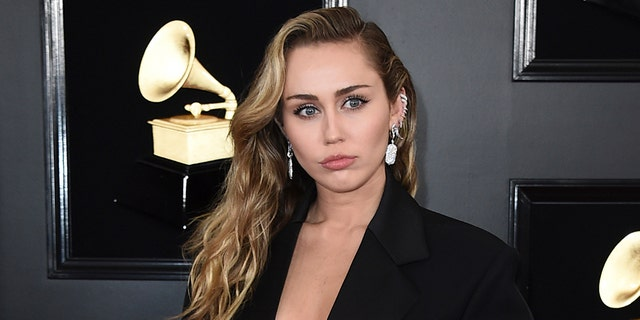 Miley Cyrus opted for a sleek and sexy black suit at Sunday night's Grammys.