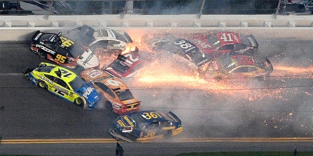 Matt DiBenedetto (95), Ryan Blaney (12), Matt Tifft (36), Aric Almirola (10), Paul Menard (21), Ryan Newman (6), David Ragan (38), Daniel Suarez (41) and Austin Dillon (3) collide between Turns 3 and 4 during the NASCAR Daytona 500 auto race at Daytona International Speedway Sunday  in Daytona Beach, Fla. (AP Photo/Phelan M. Ebenhack)