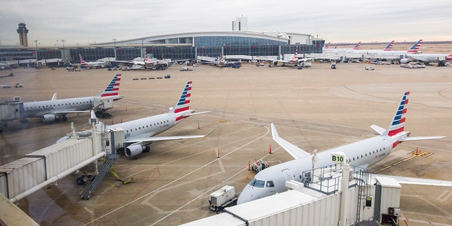 Flights in the Dallas area were delayed Wednesday afternoon when air traffic controllers were forced to evacuate the Terminal Radar Approach Control (TRACON) after a report of smoke in the building.
