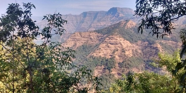 Layered lava flows within the Wai Subgroup from near Ambenali Ghat, Western Ghats. (Credit: Courtney Sprain)