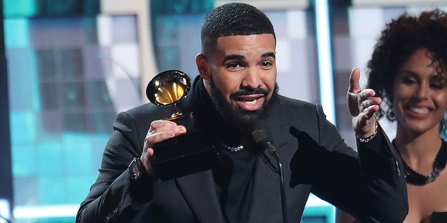 "Drake receives an award for the best ""God's Plan"" rap song at the 61st Grammy Awards in 2019 February 10, Sunday, Los Angeles. Invision / AP"
