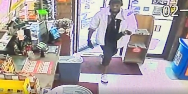 A suspect walking into a convenience store in Texas, where he duct-taped the stork clerk and set a customer on fire.