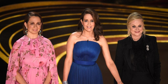 Maya Rudolph, from left, Tina Fey and Amy Poehler present the award for best performance by an actress in a supporting role at the Oscars on Sunday, Feb. 24, 2019, at the Dolby Theatre in Los Angeles. (Photo by Chris Pizzello/Invision/AP)