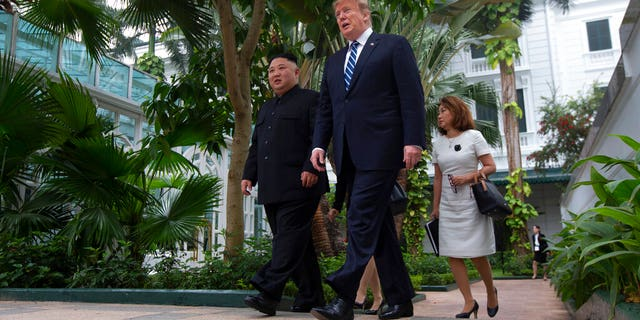 President Donald Trump and North Korean leader Kim Jong Un take a walk after their first meeting at the Sofitel Legend Metropole Hanoi hotel.