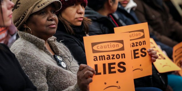 Protesters attend a New York City Council Finance Committee hearing titled 'Amazon HQ2 Stage 2: Does the Amazon Deal Deliver for New York City Residents?' at City Hall back in late January. (Photo by Drew Angerer/Getty Images)
