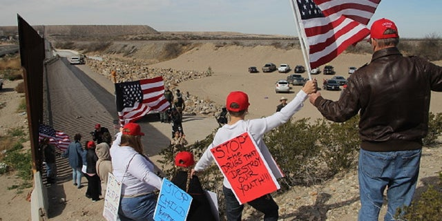 Supporters of the U.S. Republican Party make a human wall to demonstrate in favor of the construction of the border wall between the United States and Mexico, at the border between Sunland Park, New Mexico, United States and Ciudad Juarez, Chihuahua state, Mexico, on February 9, 2019. [Photo by Herika Martinez / AFP) (Photo credit should read HERIKA MARTINEZ/AFP/Getty Images)