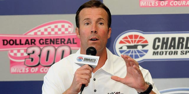 J.D. Gibbs, who died Jan. 11 at age 49, was president of Joe Gibbs Racing and the son of former NFL head coach Joe Gibbs. He is seen speaking at a news conference in Concord, N.C., Oct. 14, 2011. (Associated Press)