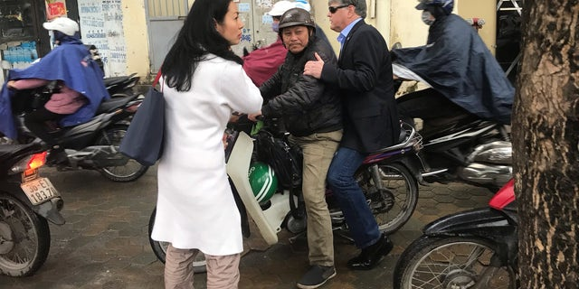 Sean Hannity riding a scooter in Vietnam.