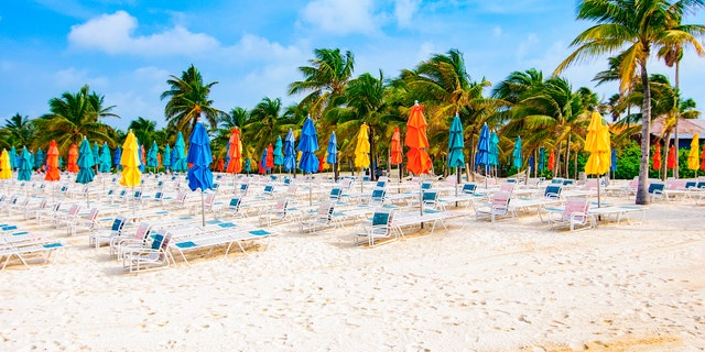 Beach chairs and umbrellas line the beaches of Castaway Cay