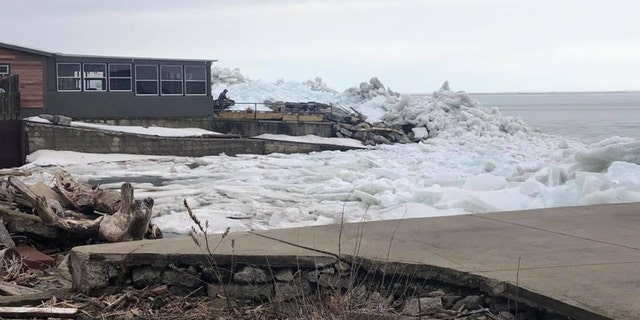 The ice mounds spurred an voluntary evacuation for residents in Hoover Beach on Sunday.