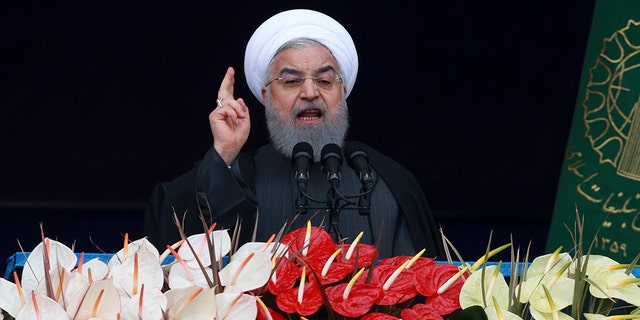 Iranian President Hassan Rouhani speaks during a ceremony celebrating the 40th anniversary of the Islamic Revolution.