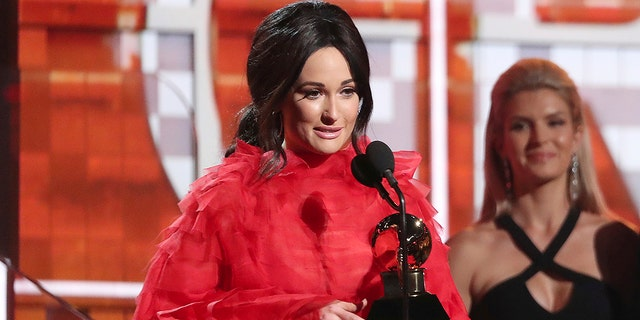 """Kacey Musgraves accepts the award for best country album for """"Golden Hour"""" at the 61st annual Grammy Awards on Sunday, Feb. 10, 2019, in Los Angeles."""