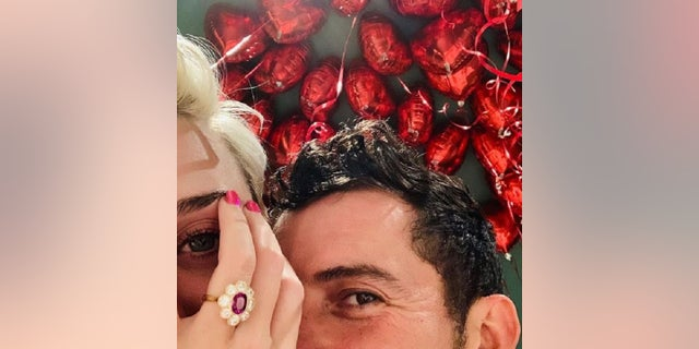 KatyPerry shows off her ring on Instagram after her Valentine's Day engagement to Orlando Bloom.