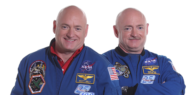 File photo - Scott Kelly (left) spent a year in space while his identical twin Mark (right) stayed on Earth as a control subject.
